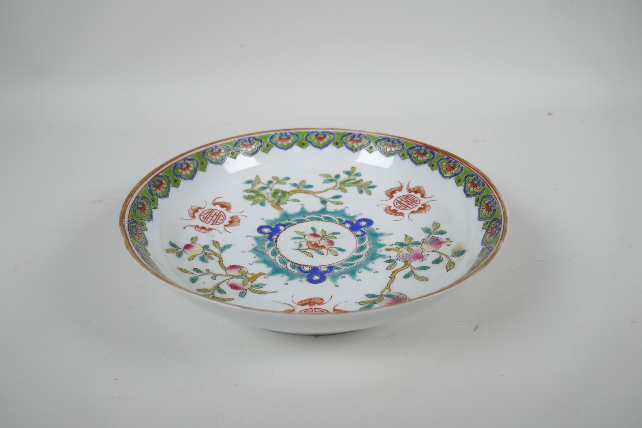 An early C20th Chinese famille verte porcelain dish decorated with bats, auspicious symbols and - Image 2 of 3