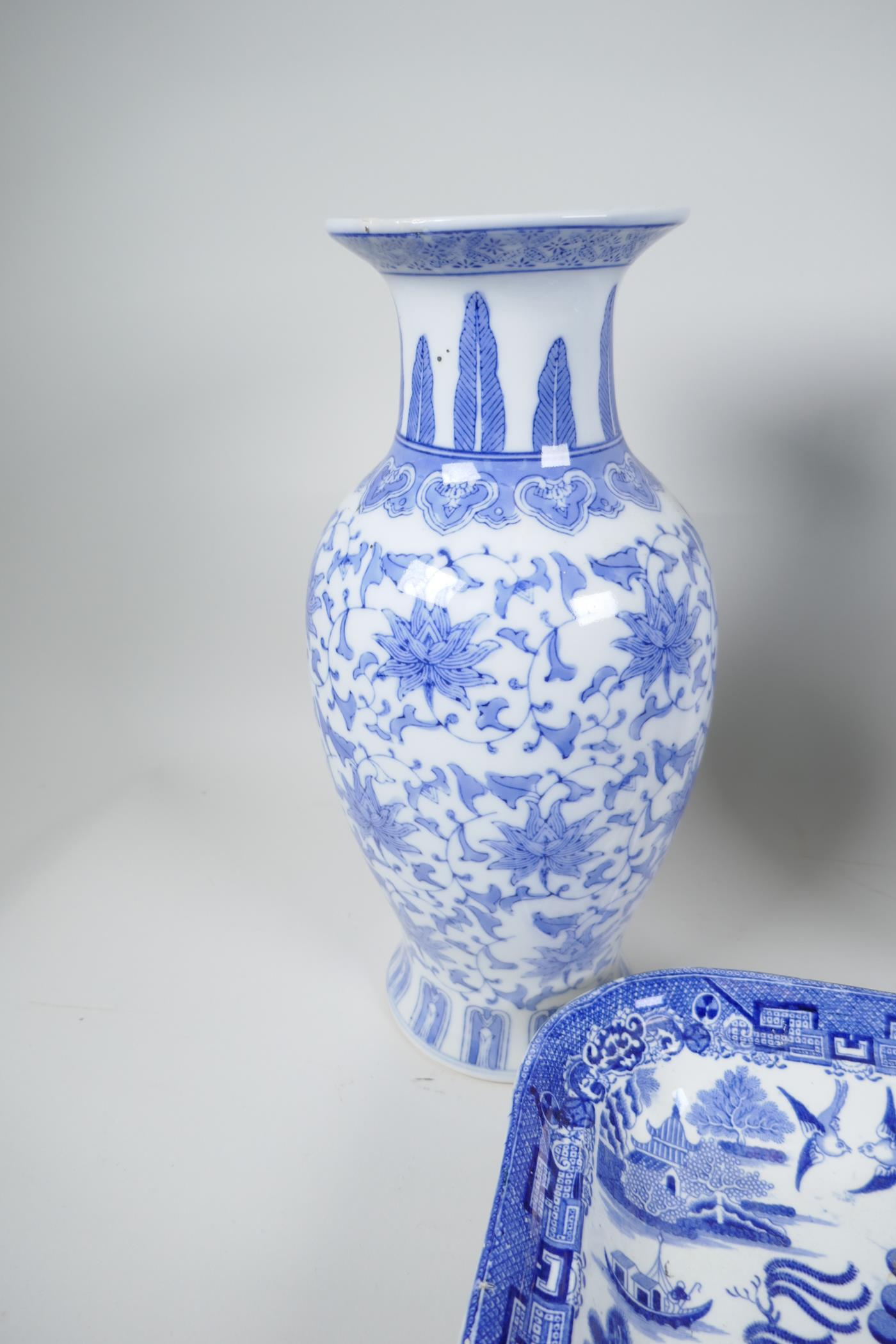 """A pair of Chinese blue and white vases decorated with stylised flowers, 12"""" high, together with a - Image 3 of 3"""
