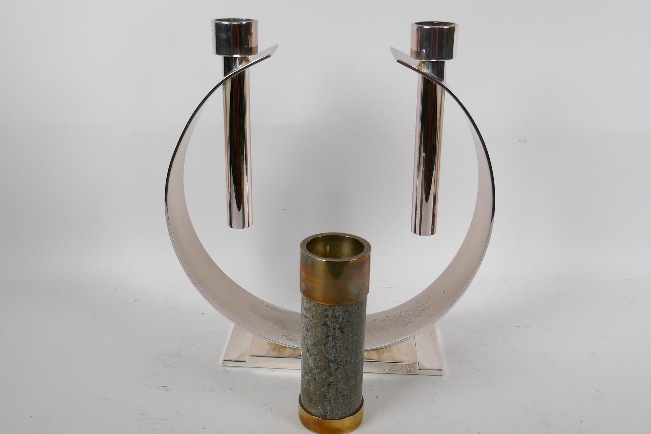 """An unusual plated metal two light candlestick 'The Luna' by FWK, 11½"""" high, together with a"""