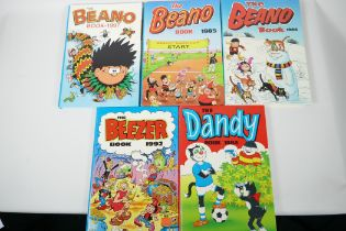 Four children's annuals, The Dandy 1984, The Beano 1984-85 and 1997, and The Beezer 1992
