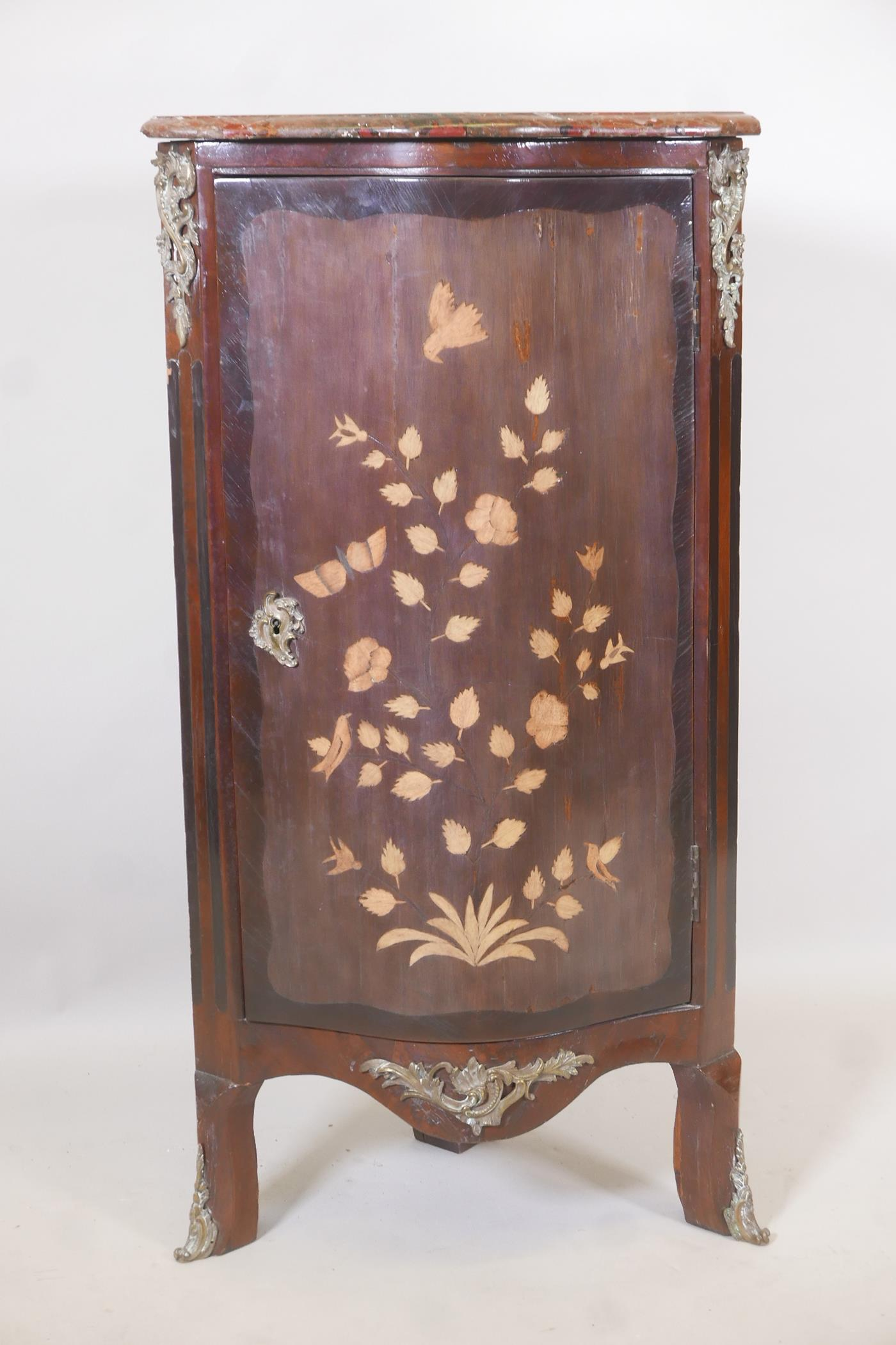 An early C19th French inlaid standing corner cupboard, with rouge marble top and serpentine front