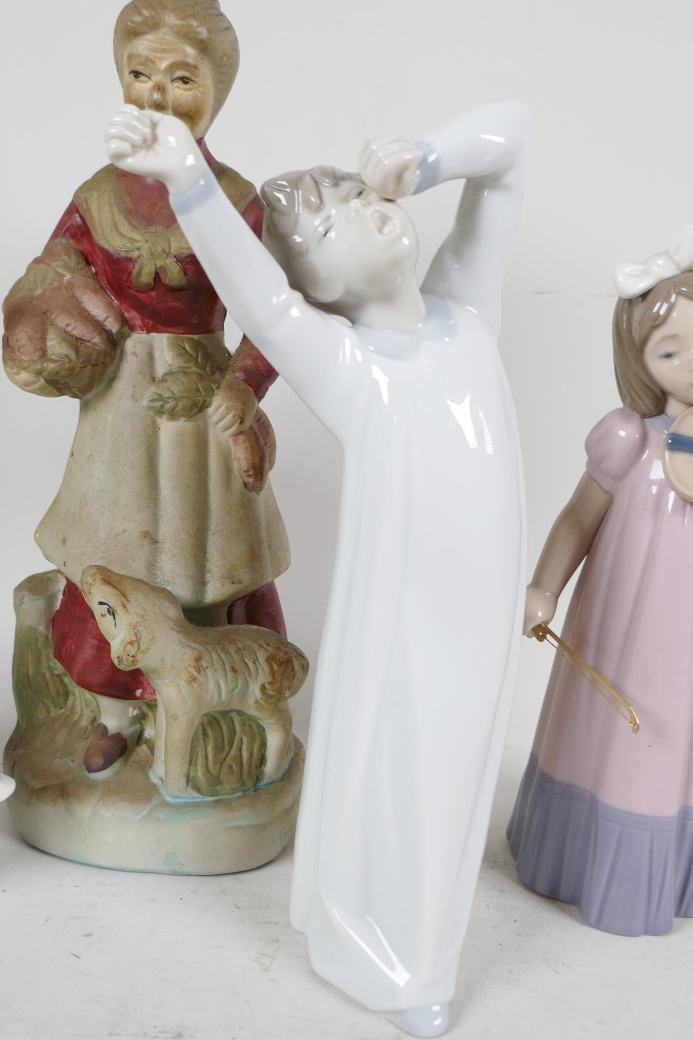 Two Lladro figures, sleepy boy and woman with geese (missing finger), a Nao Daisia figure of a - Image 3 of 5