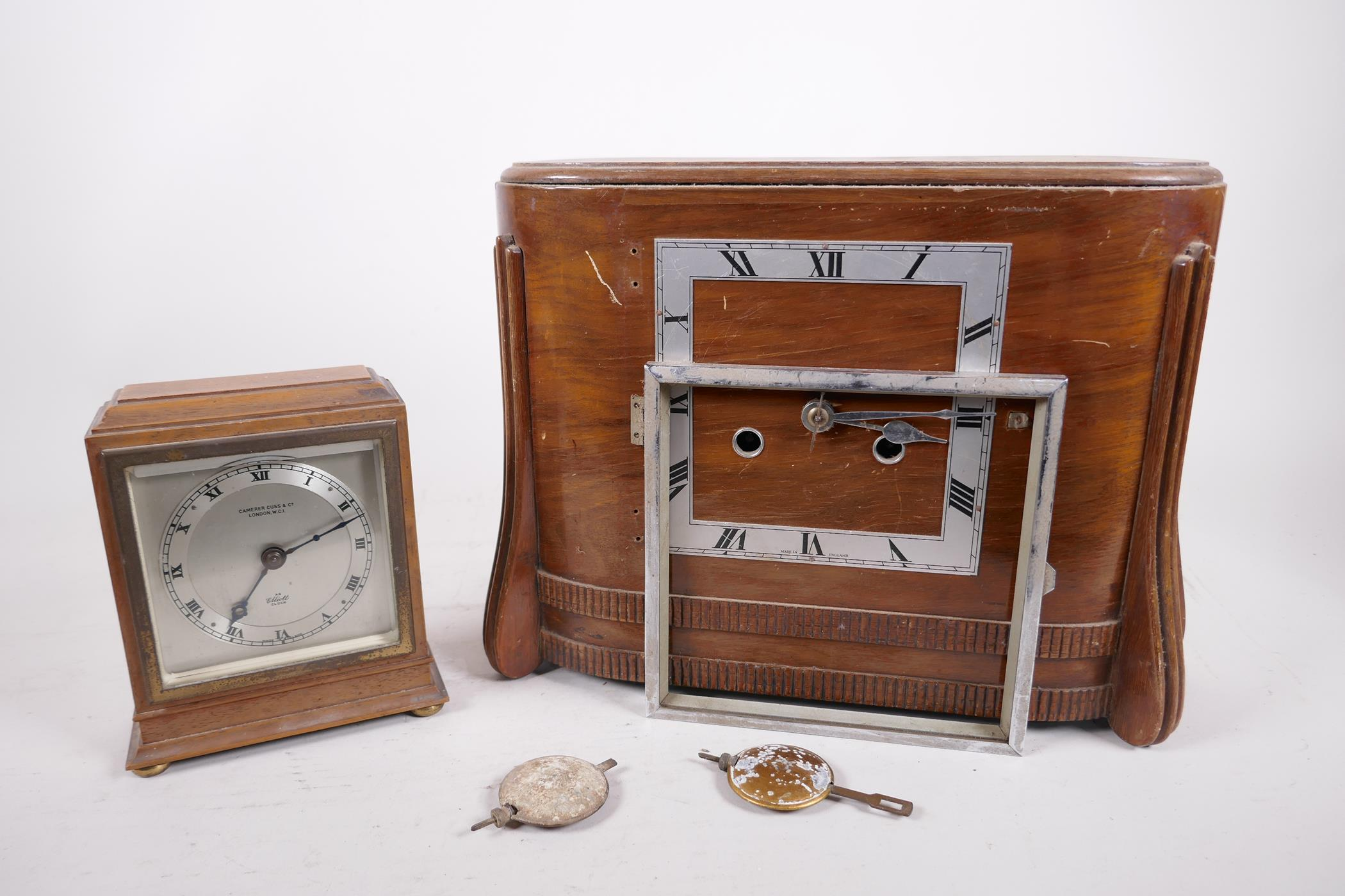 A Carrera Cuss walnut cased mantel clock, the silvered dial and chapter ring with Roman numerals and