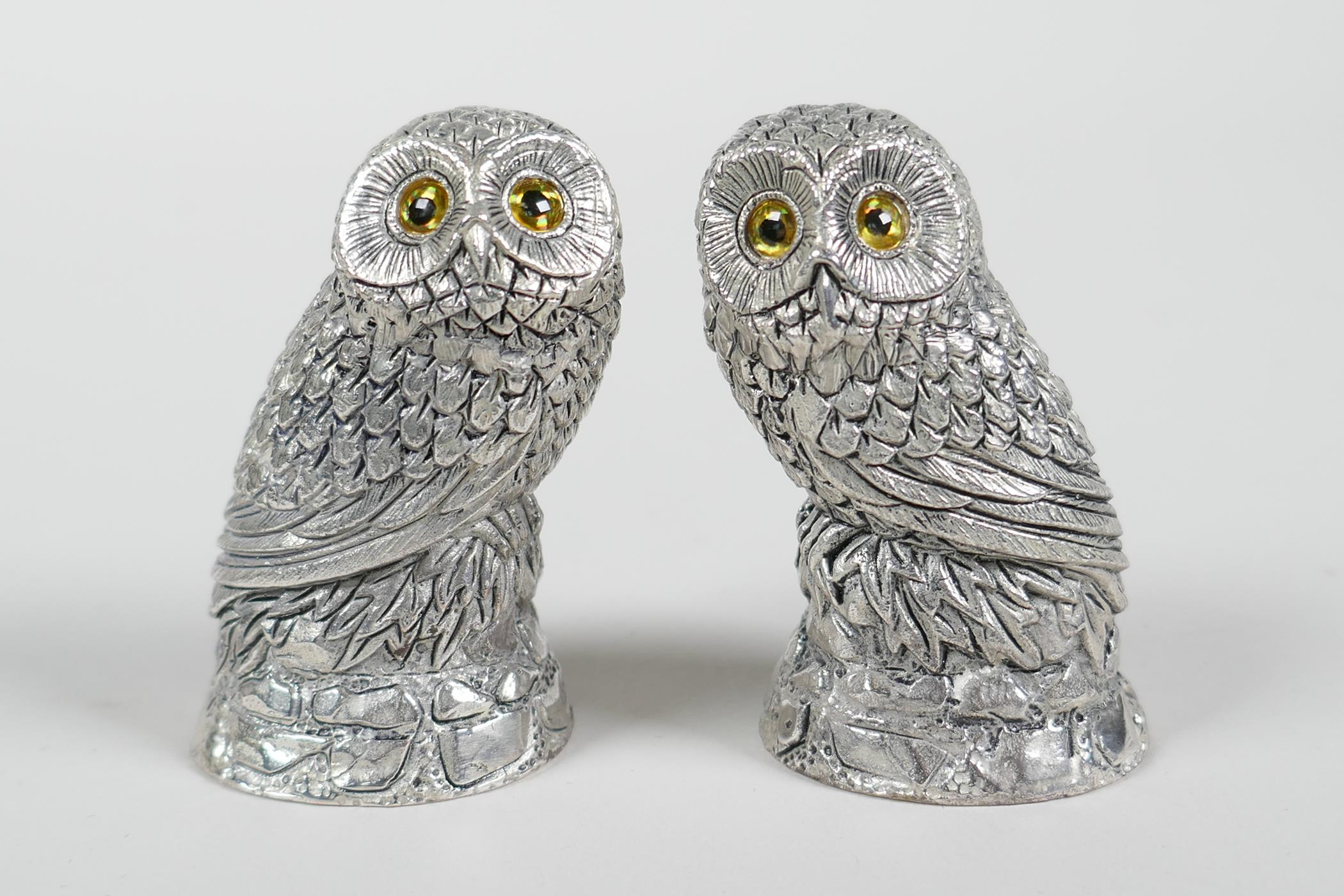"""A pair of silver plated owl condiments, 2"""" high"""