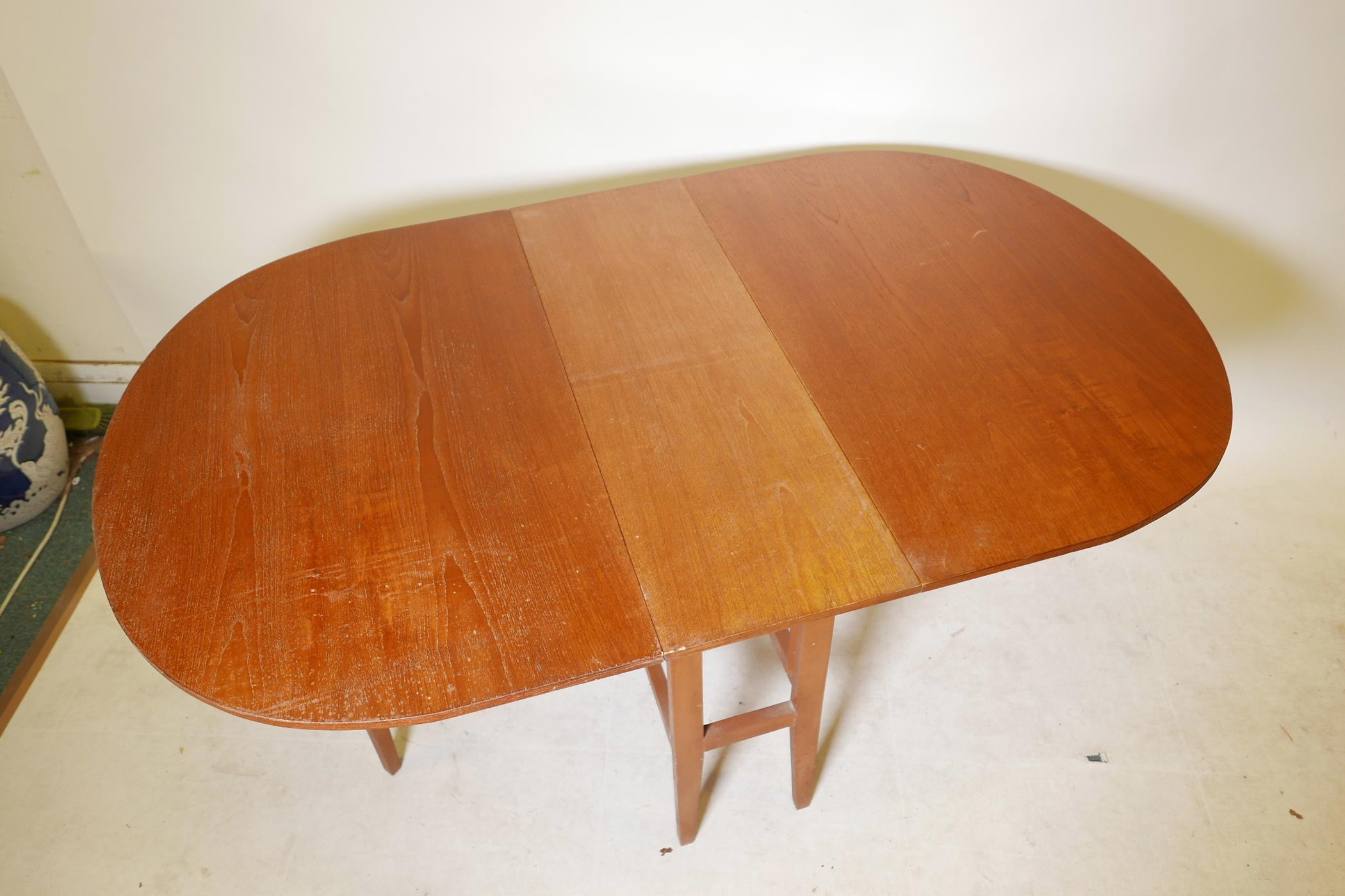 "A 1970s teak gateleg table, 59"" x 35½"", 29"" high extended - Image 3 of 3"