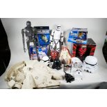 A collection of Star Wars toys and ephemera including K-2SO and First Order storm trooper figures,