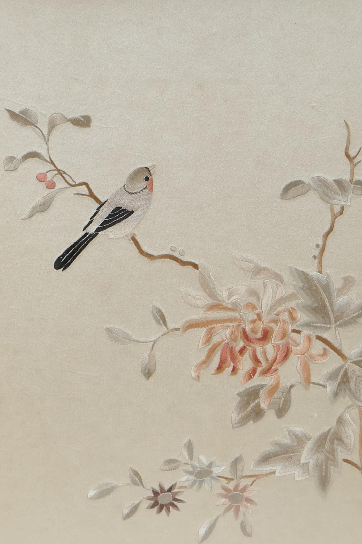 """A Chinese silk embroidery depicting birds on a branch in bloom, 10½"""" x 13"""""""