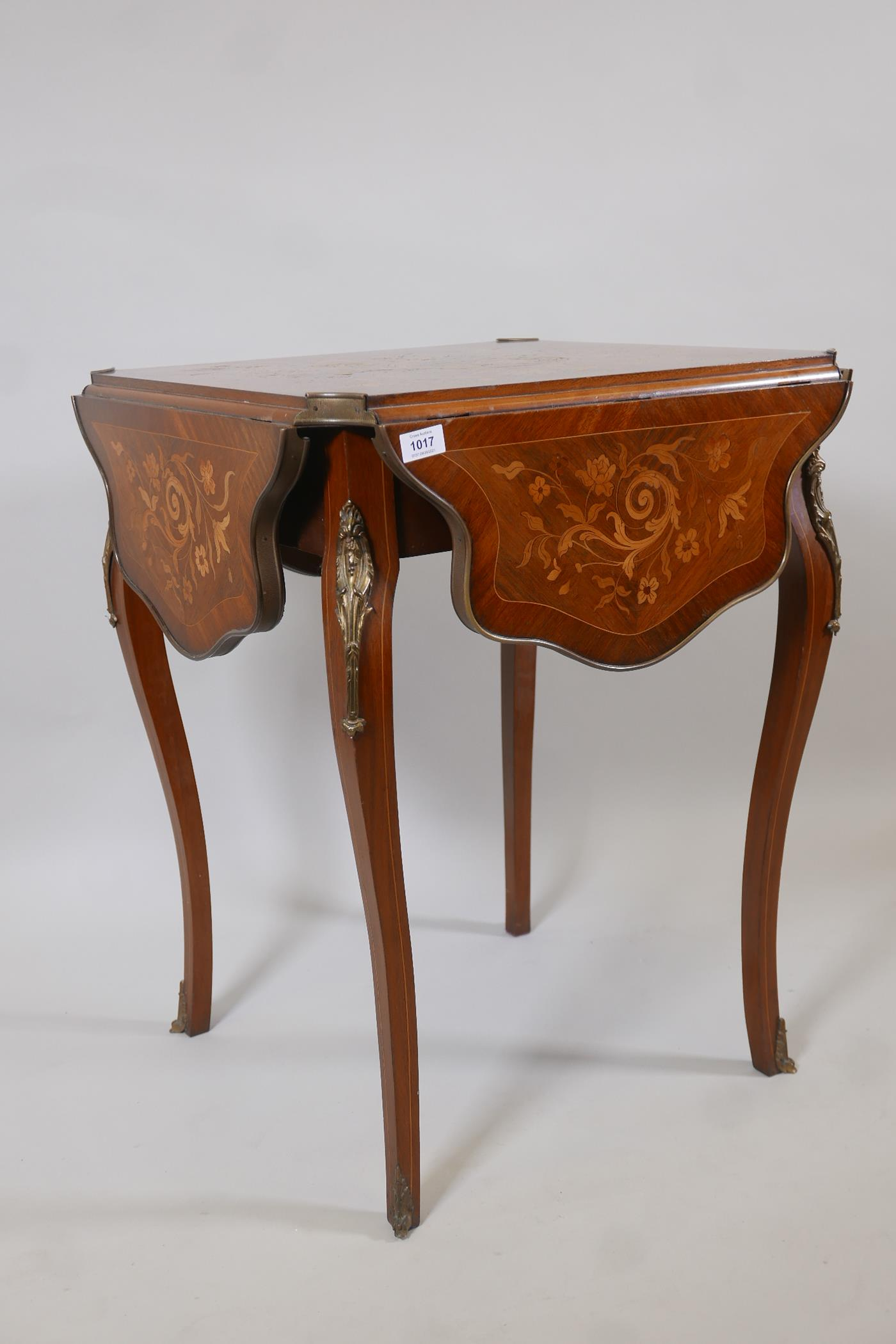 A French C19th marquetry inlaid rosewood centre table, with shaped drop leaves and gilt brass