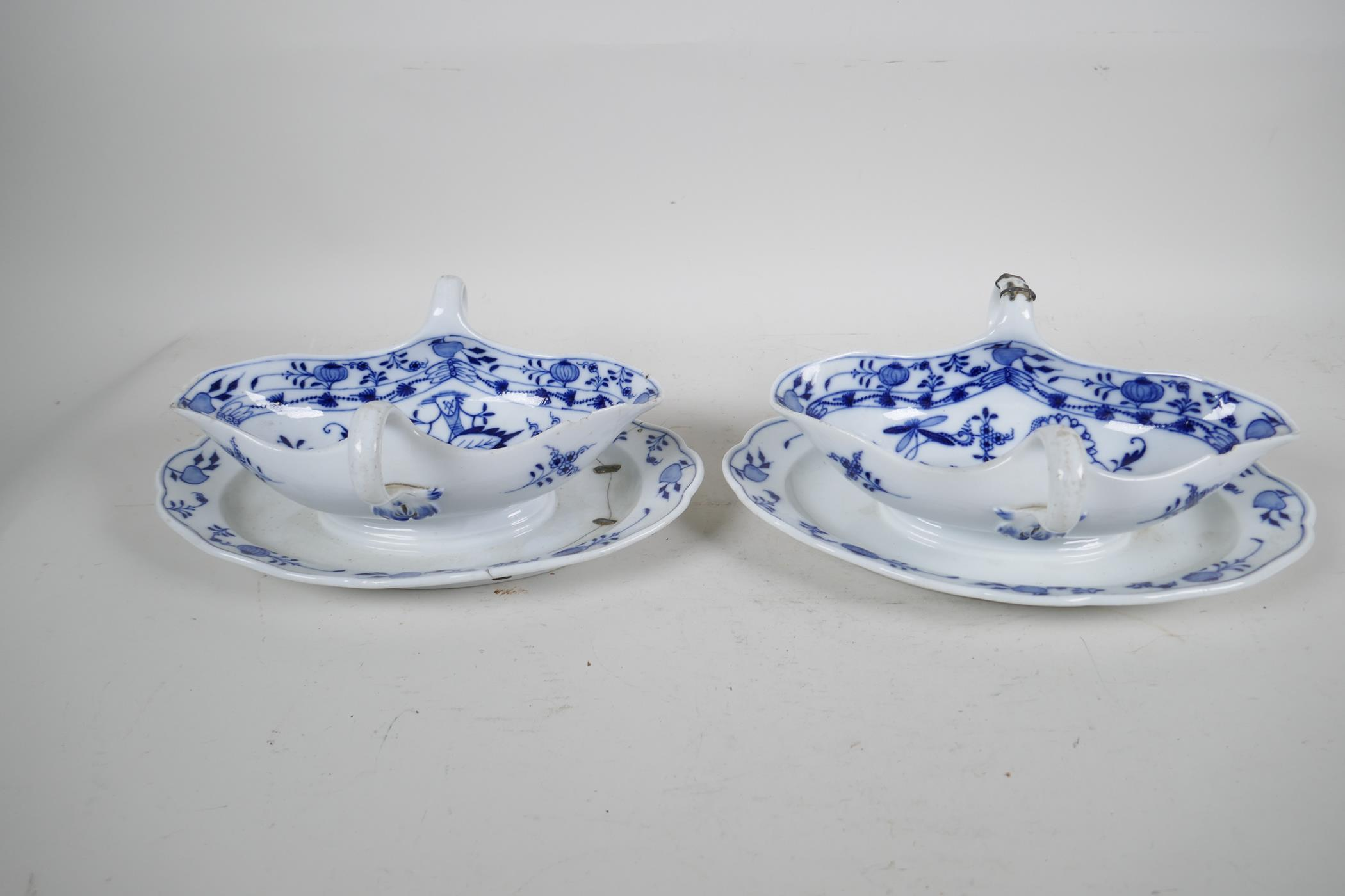 """A pair of late C18th/early C19th Meissen 'Onion' Pattern blue and white two handled gravy boats, 10"""""""