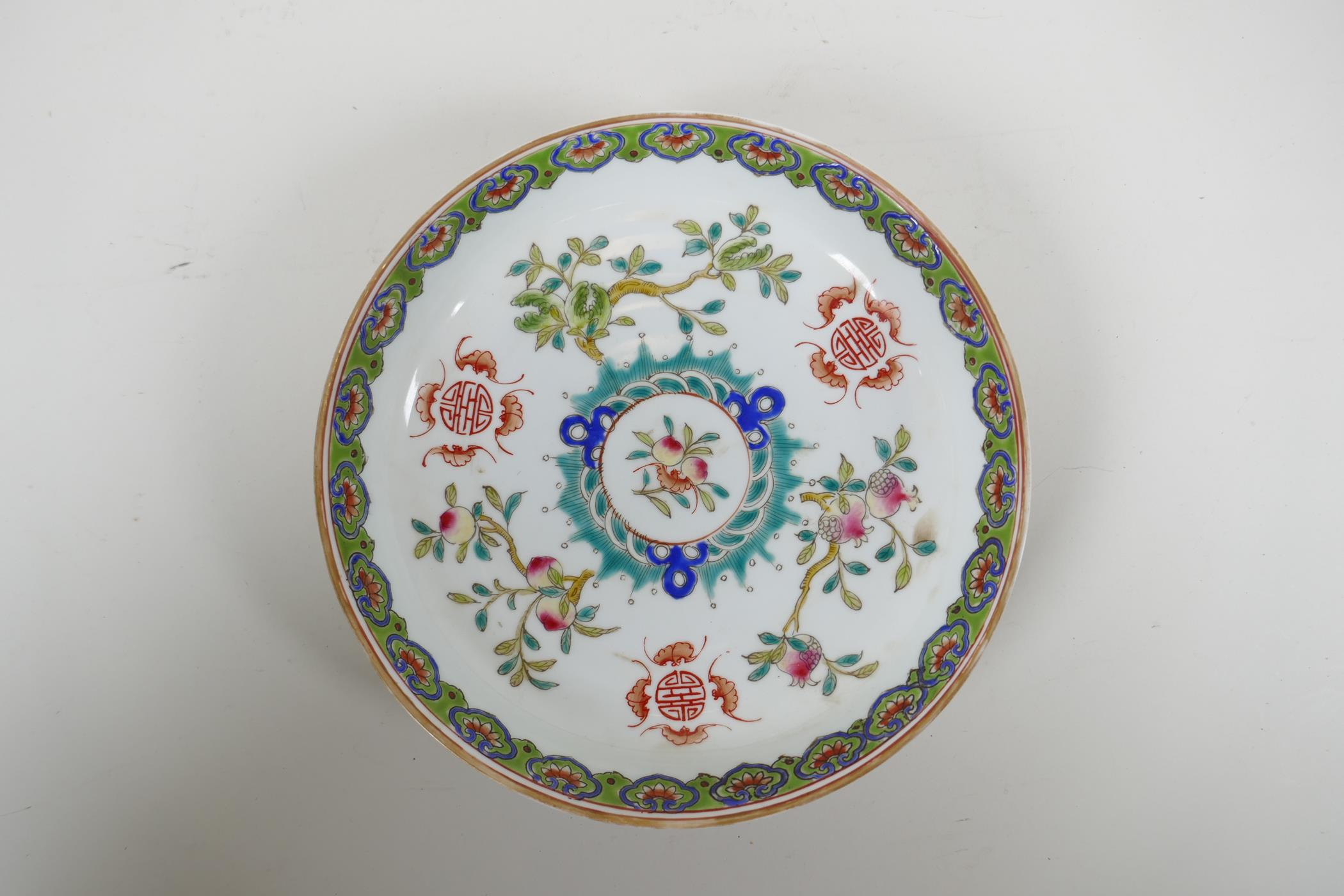 An early C20th Chinese famille verte porcelain dish decorated with bats, auspicious symbols and