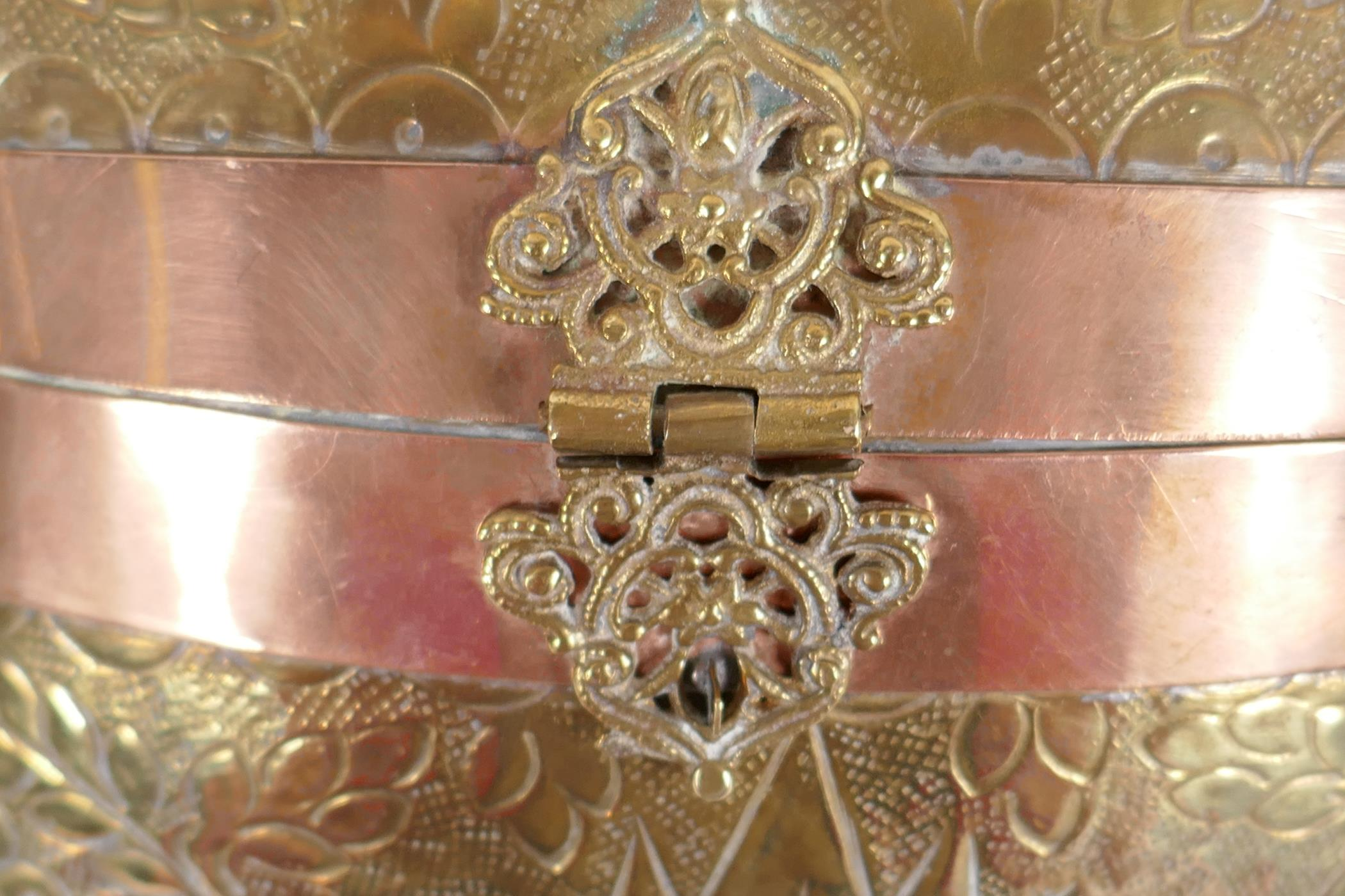 An Indian brass cushion shaped shoulder purse with engraved floral decoration, coppered bands and - Image 2 of 4