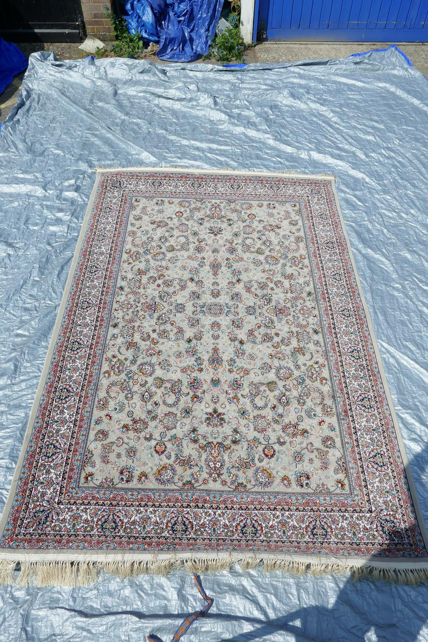 """A fine woven beige ground full pile Iranian carpet with an all over floral pattern, 118"""" x 78"""""""