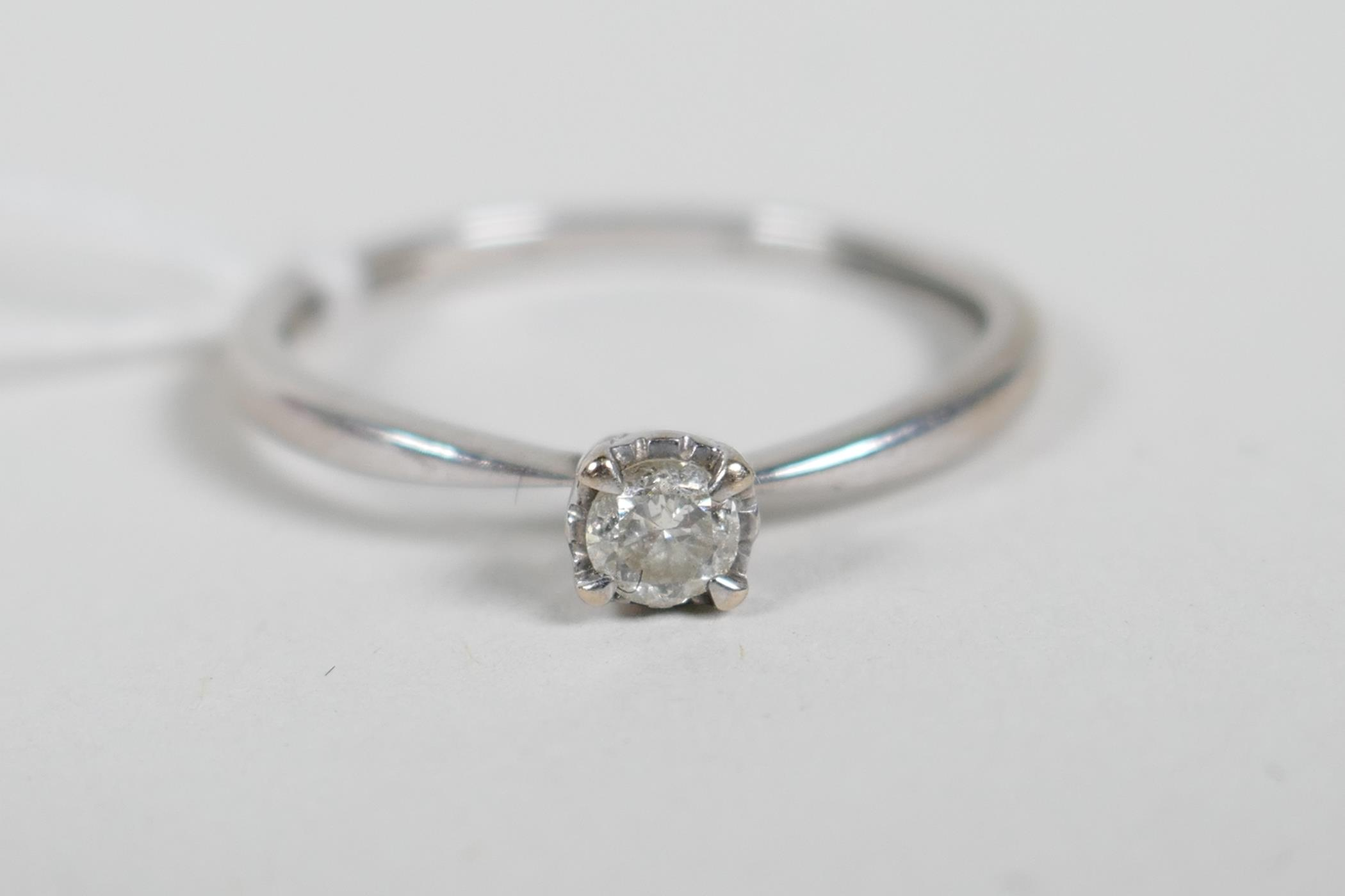 An 18ct white gold and diamond engagement ring, approximate size 'N'