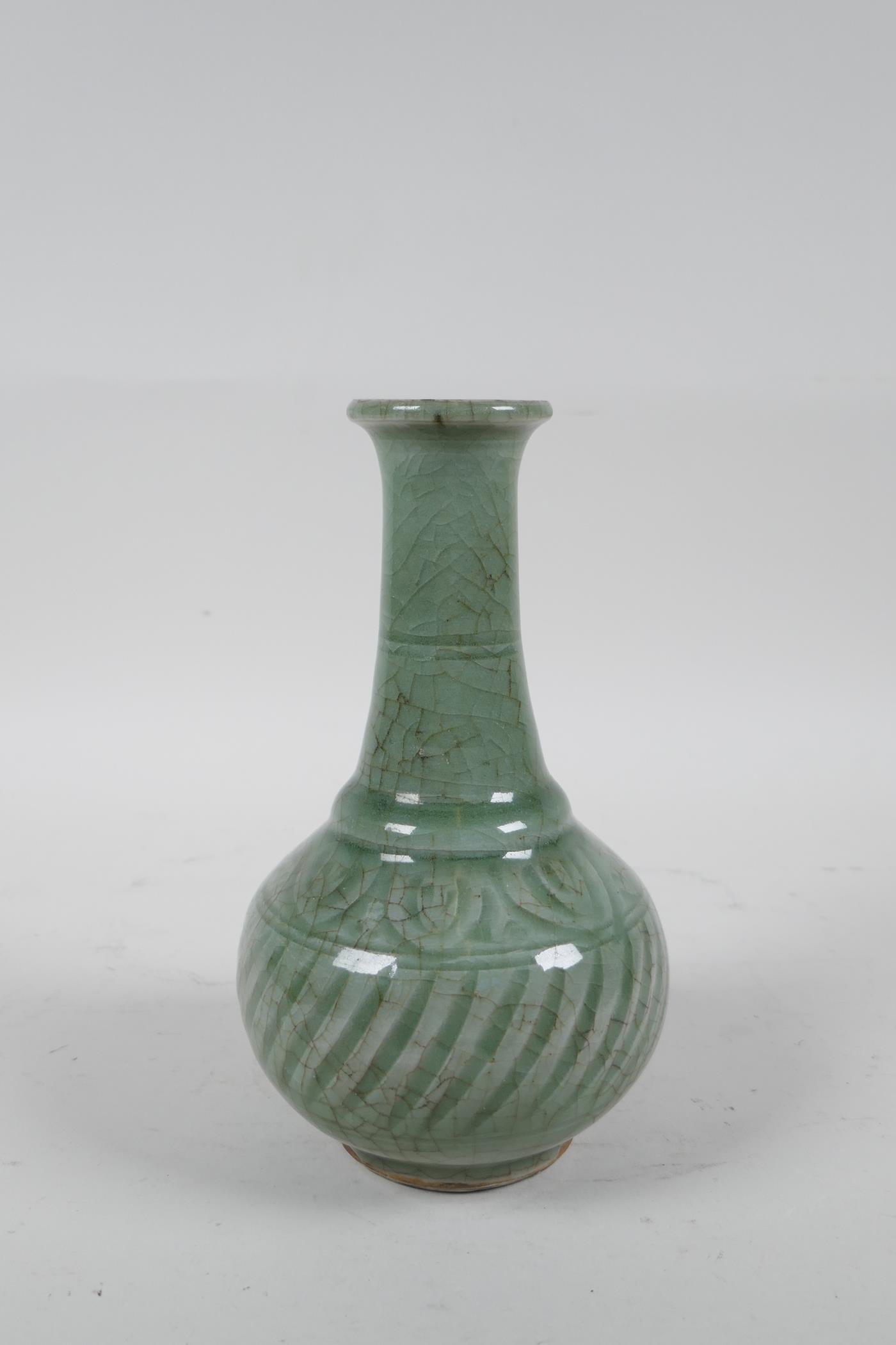 """A Chinese celadon glazed porcelain vase with ribbed spiral decoration to the body, 6½"""" high"""
