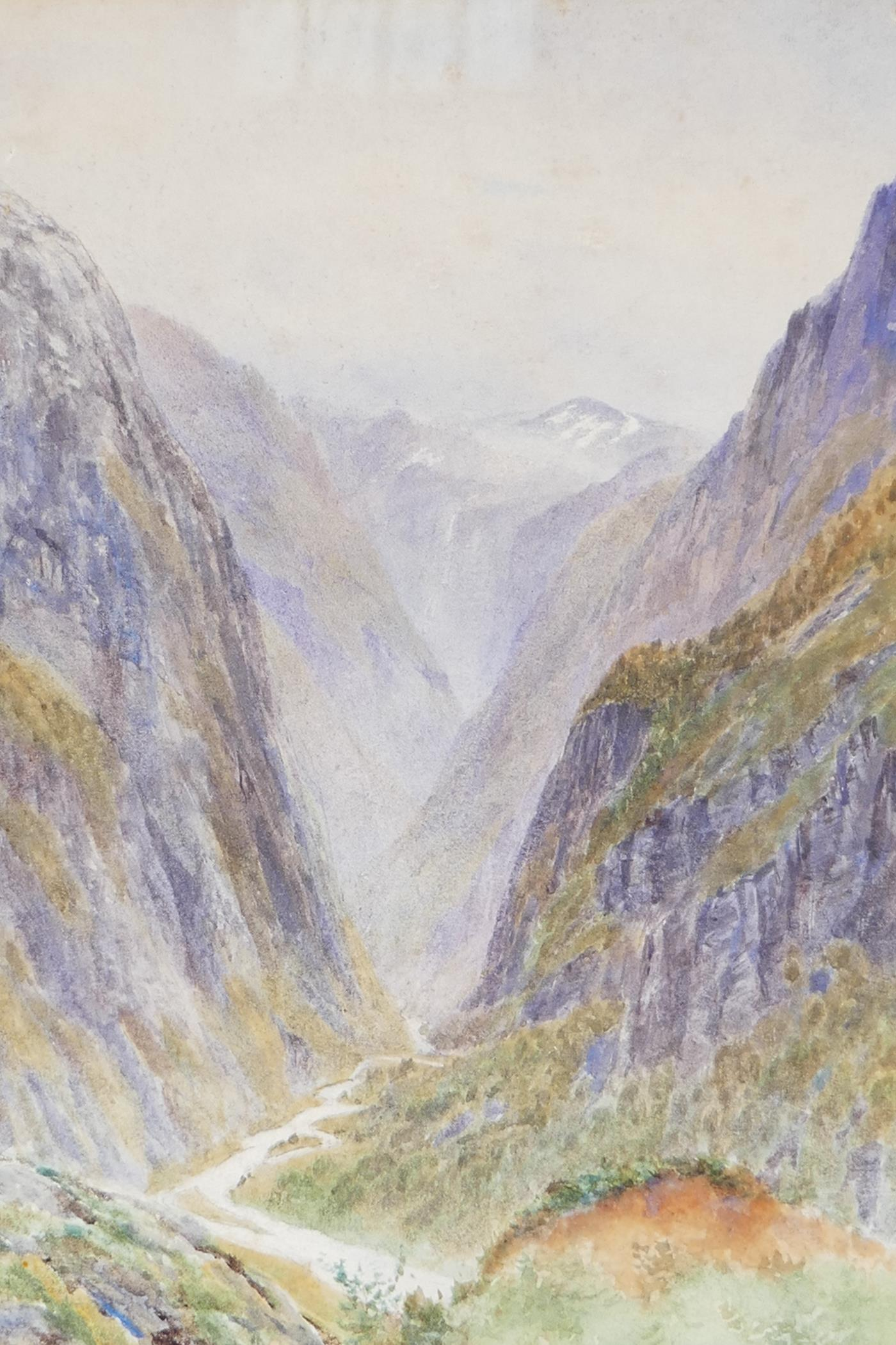 """A watercolour mountain landscape with deep river gorge initialled RJM, 9½"""" x 13½"""","""
