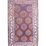 """A blue ground Middle Eastern wool rug with a Bokhara style design, 41"""" x 72"""""""