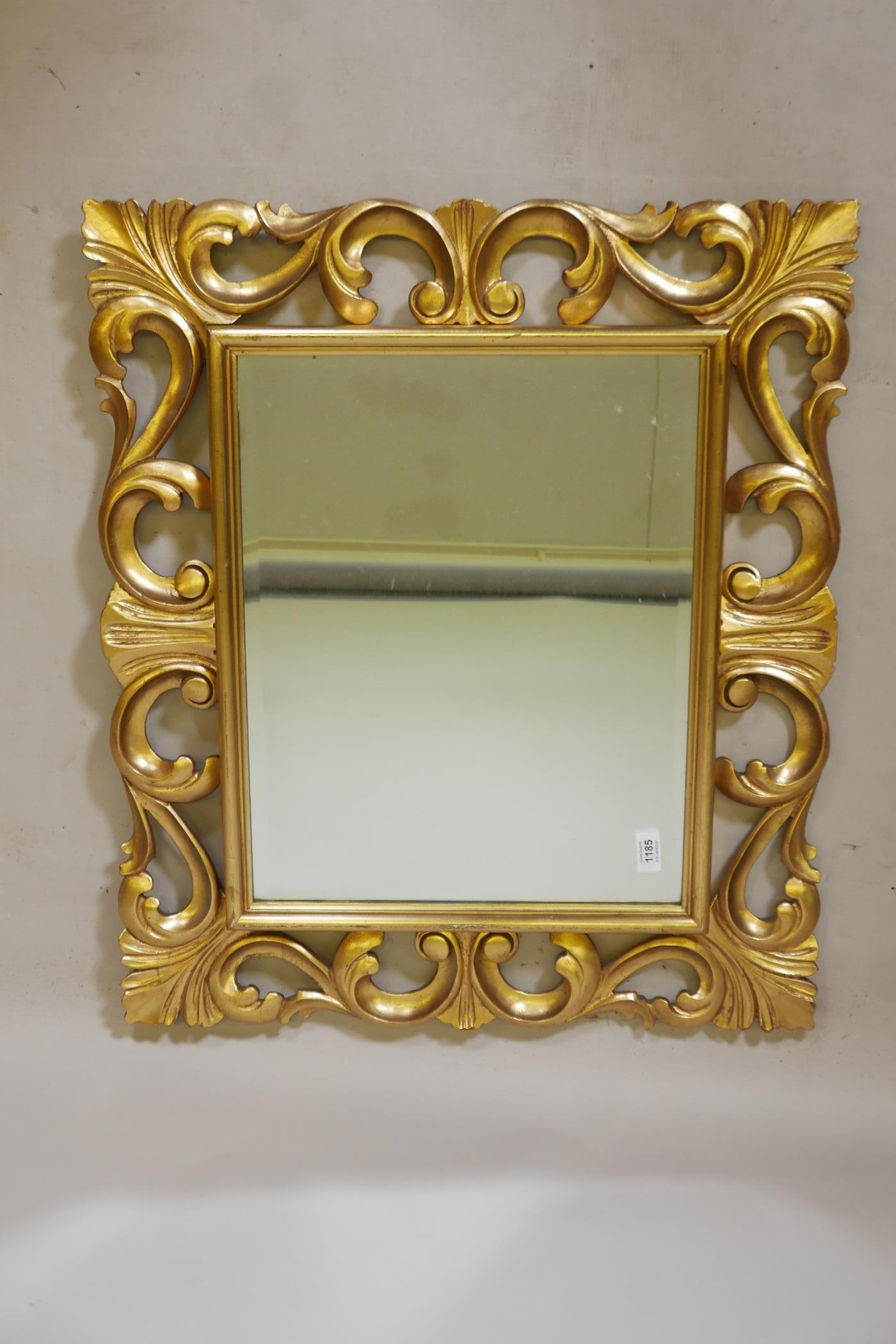 """A carved giltwood Florentine style wall mirror with bevelled glass, mid C20th, 25"""" x 30"""""""