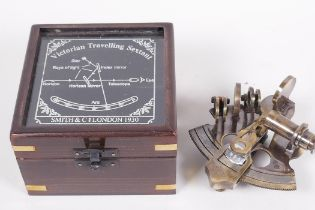 """A replica brass travelling sextant in a hardwood case, 4½"""" square"""
