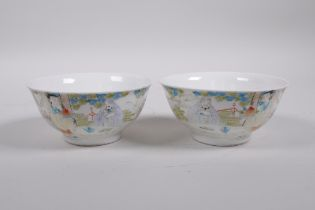 A pair of Chinese polychrome porcelain rice bowls decorated with figures eating peaches, inscription