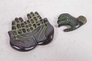 An Indian bronze trinket dish in the form of cupped hands, and a bronze ornament in the form of a