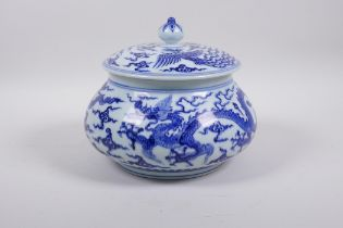 A Chinese Ming style blue and white porcelain jar and cover of squat form with dragon and phoenix