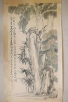 A Chinese watercolour scroll depicting a rocky outcrop with banana palms and flowers, character