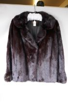 """A lady's mink fur jacket from Charles Moss Furs, approximate size 14, 22"""" long"""