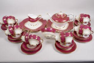 An early C20th Paragon bone china twelve place setting tea service with teapot, cream jug, sugar