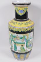 A Chinese porcelain black and yellow glazed Rouleau shaped vase incorporating panels decorated