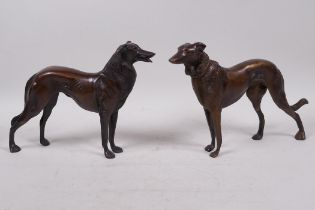 """A pair of bronze figures of hounds, 6½"""" high"""