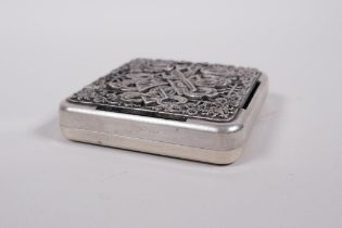 A Sino-Tibetan white metal incense box and cover, with auspicious symbol and lotus flower decoration