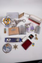 Miscellaneous items including a chrome and enamel AA badge, flasks, harmonica etc