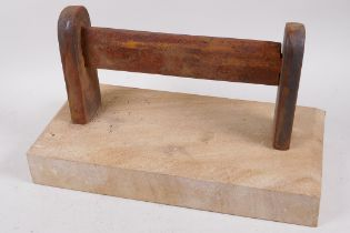 """A cast iron boot scraper mounted on a sandstone base, 12"""" long"""