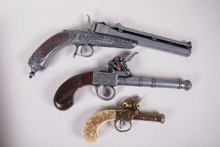 "Two replica flint lock pistols and a replica duelling pistol, 13"" long"