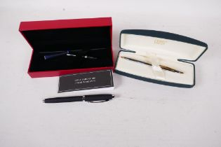 A boxed Ferrari fountain pen with refil, together with a boxed Cross ball point pen