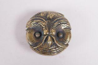 "A brass vesta in the form of an owl head, 1½"" diameter"