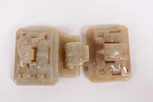 """A Chinese celadon hardstone belt buckle with carved dragon decoration, 5"""" wide"""