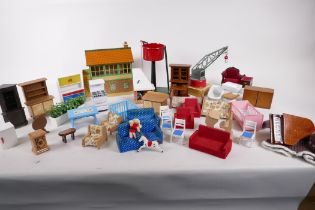 Three Hornby railway items, signal box, water tank and crane, together with a quantity of dolls