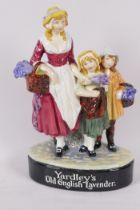 A rare Royal Doulton figure group of a woman with two children, advertising Yardley's Old English