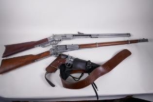 Two replica American western rifles and a replica Colt revolver in holster and belt