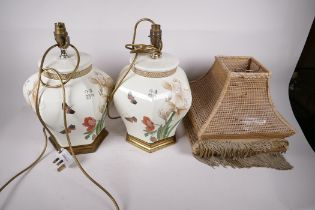 """A pair of Chinese pottery hexagonal table lamps, decorated with flowers and butterflies, signed, 15"""""""