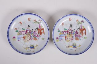A pair of C19th Chinese famille rose enamelled porcelain dishes, decorated with women and children,