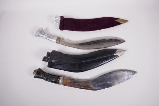 """Two replica Kukri knives, both in scabbards, with sharpeners, largest 17"""" long"""
