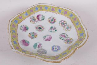 A C19th Chinese petal rimmed footed bowl painted in bright polychrome enamels, red seal mark to