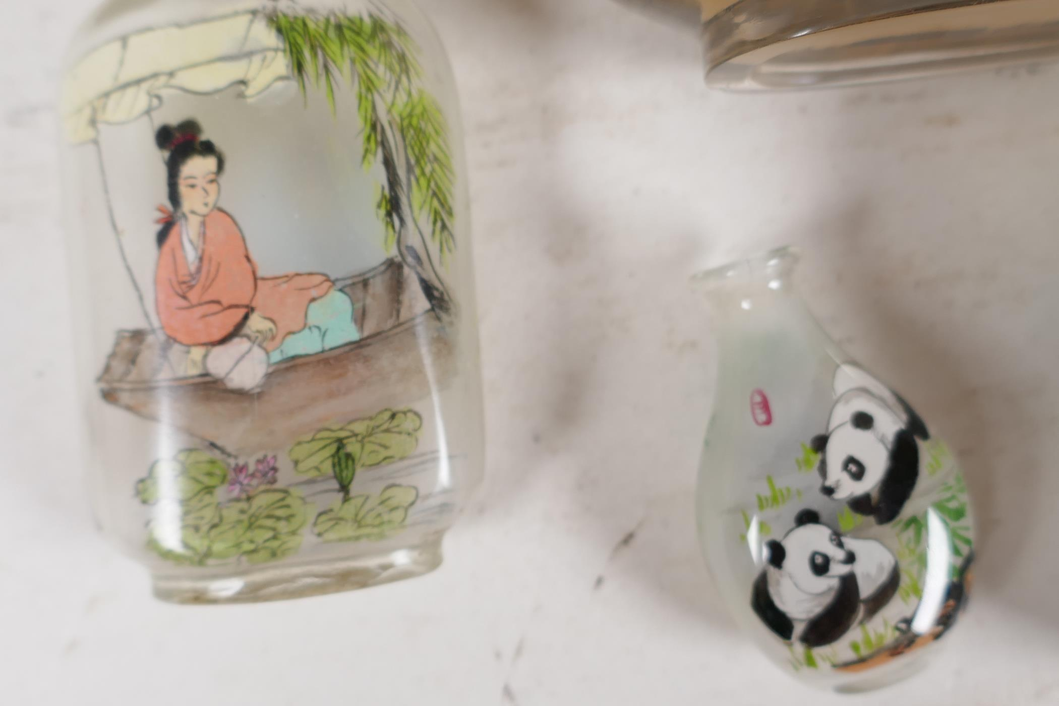 A large Chinese interior decorated snuff bottle depicting a harbour scene and figures on a bridge, - Image 2 of 5