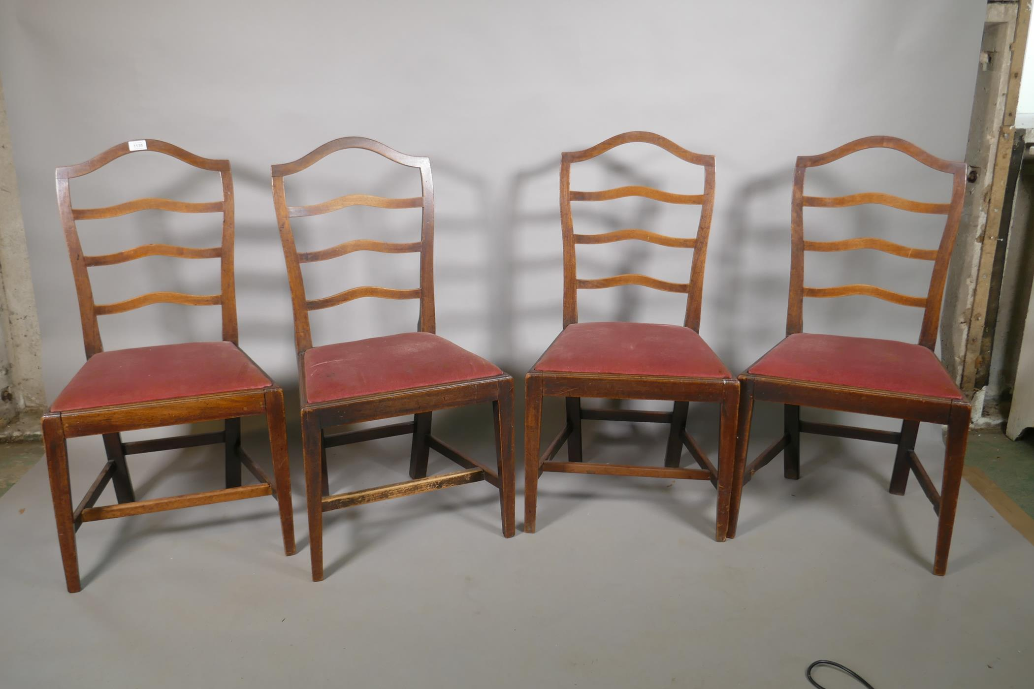 """A set of four C19th mahogany ladder back chairs with drop in seats, 38"""" high"""