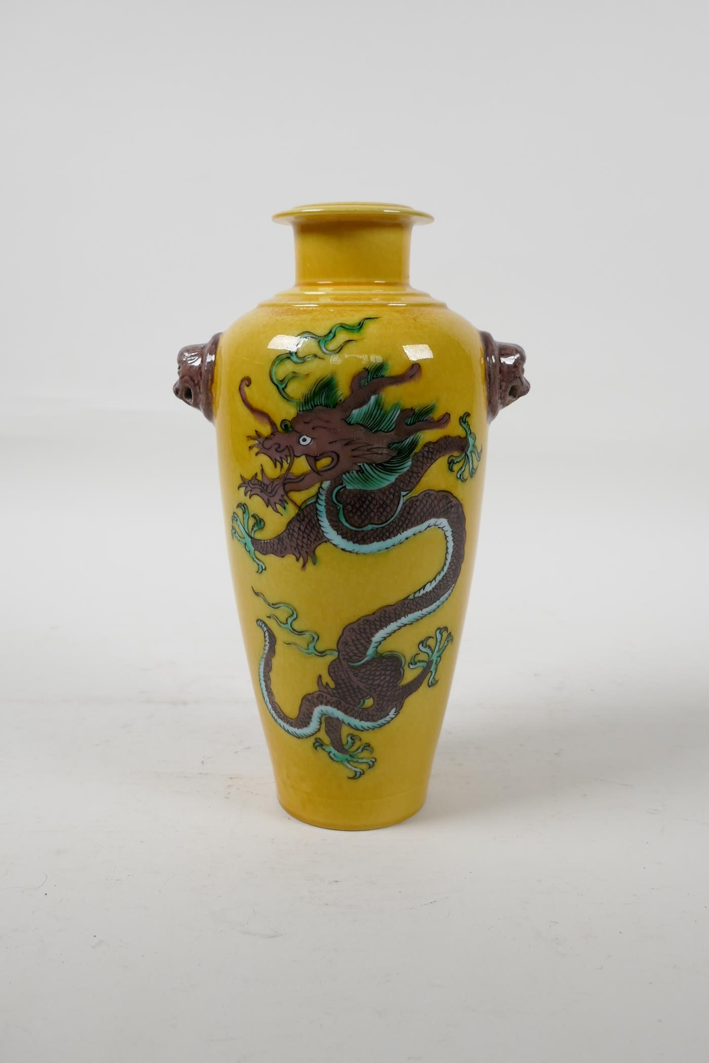 A Chinese Sancai glazed porcelain vase with two lion mask handles and dragon decoration, six - Image 3 of 5