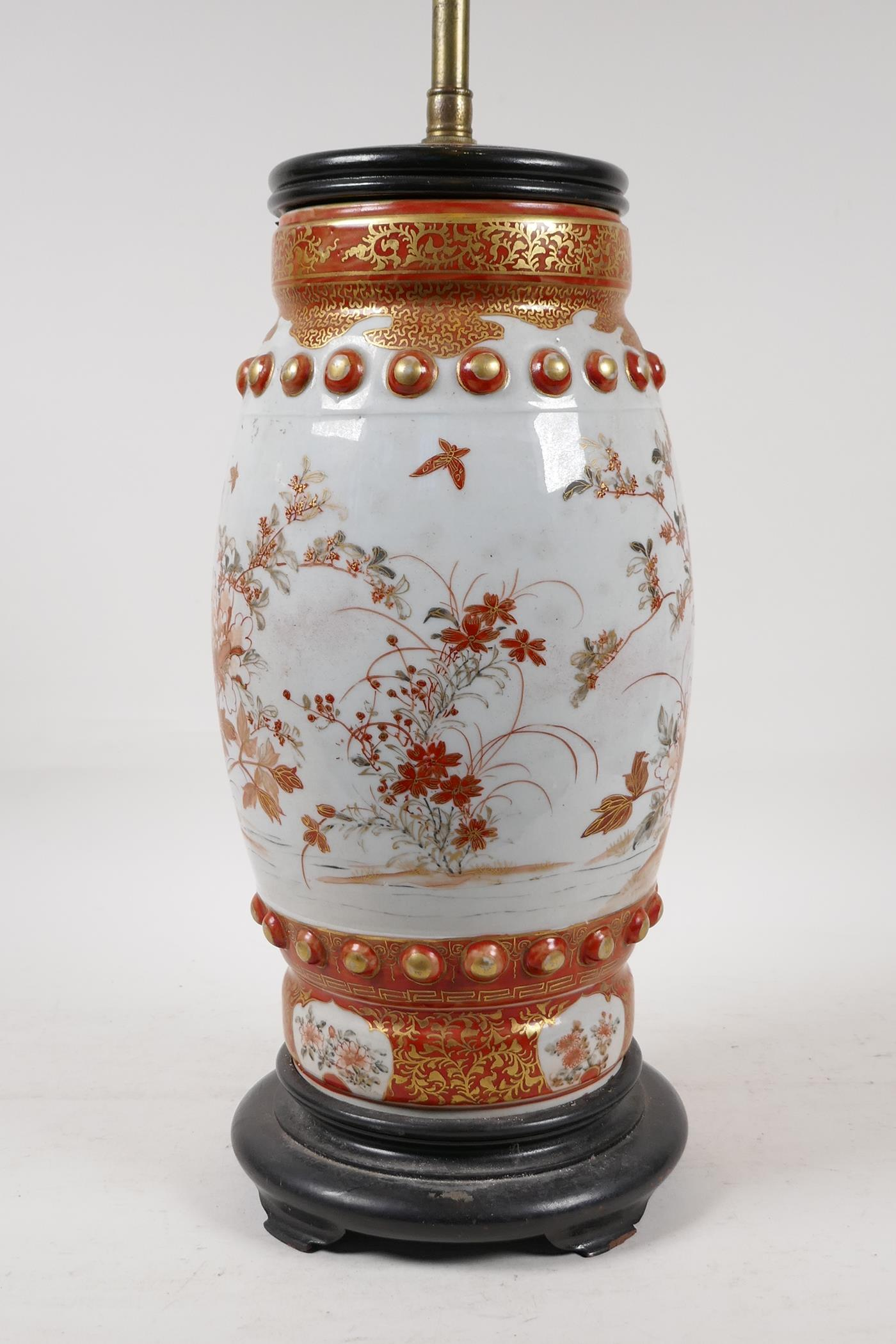A Japanese Meiji period satsuma pottery vase decorated with flowers and butterflies, converted to