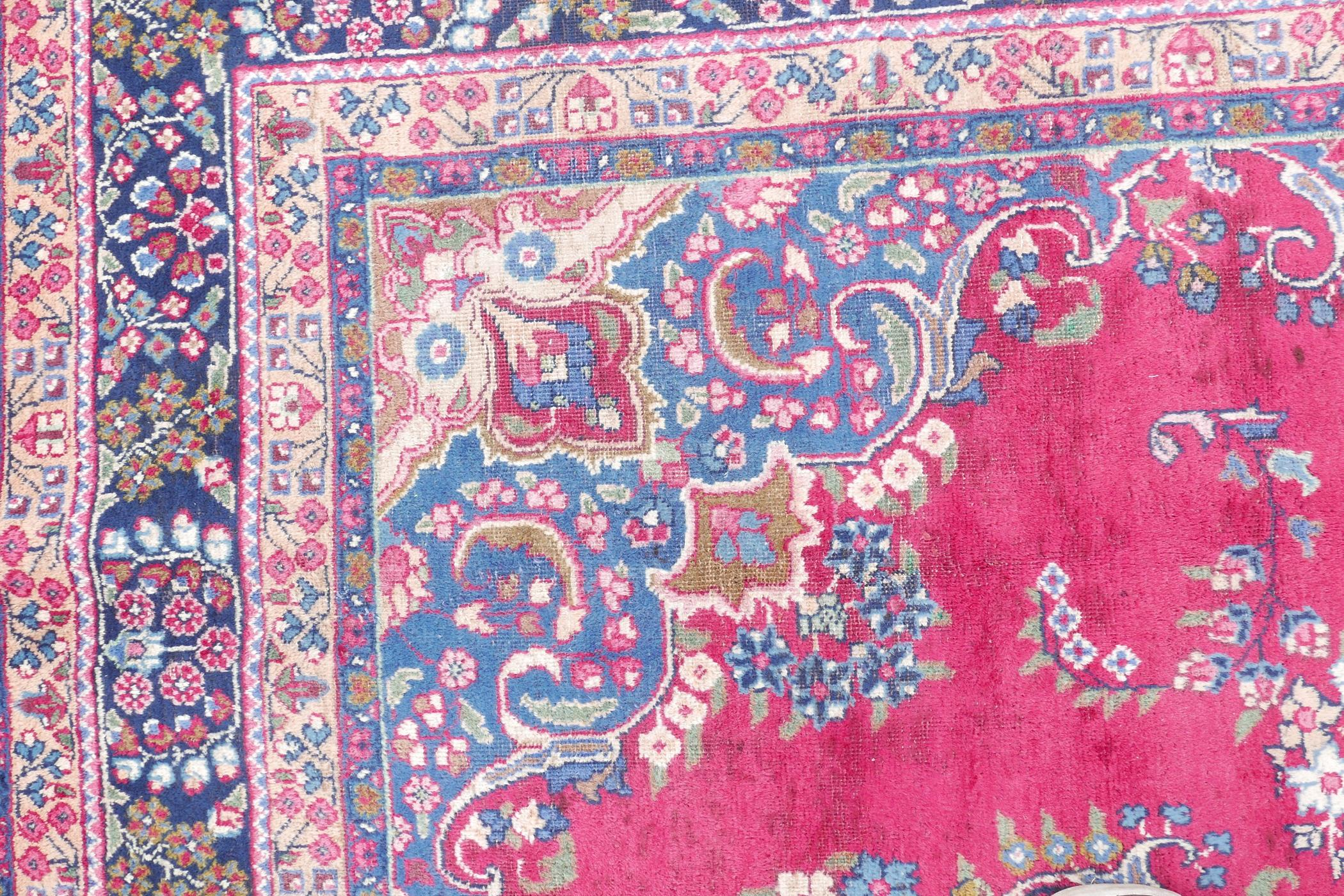 """A pink/red ground Persian Kashmar carpet with a floral medallion design, 77"""" x 117"""" - Image 3 of 7"""