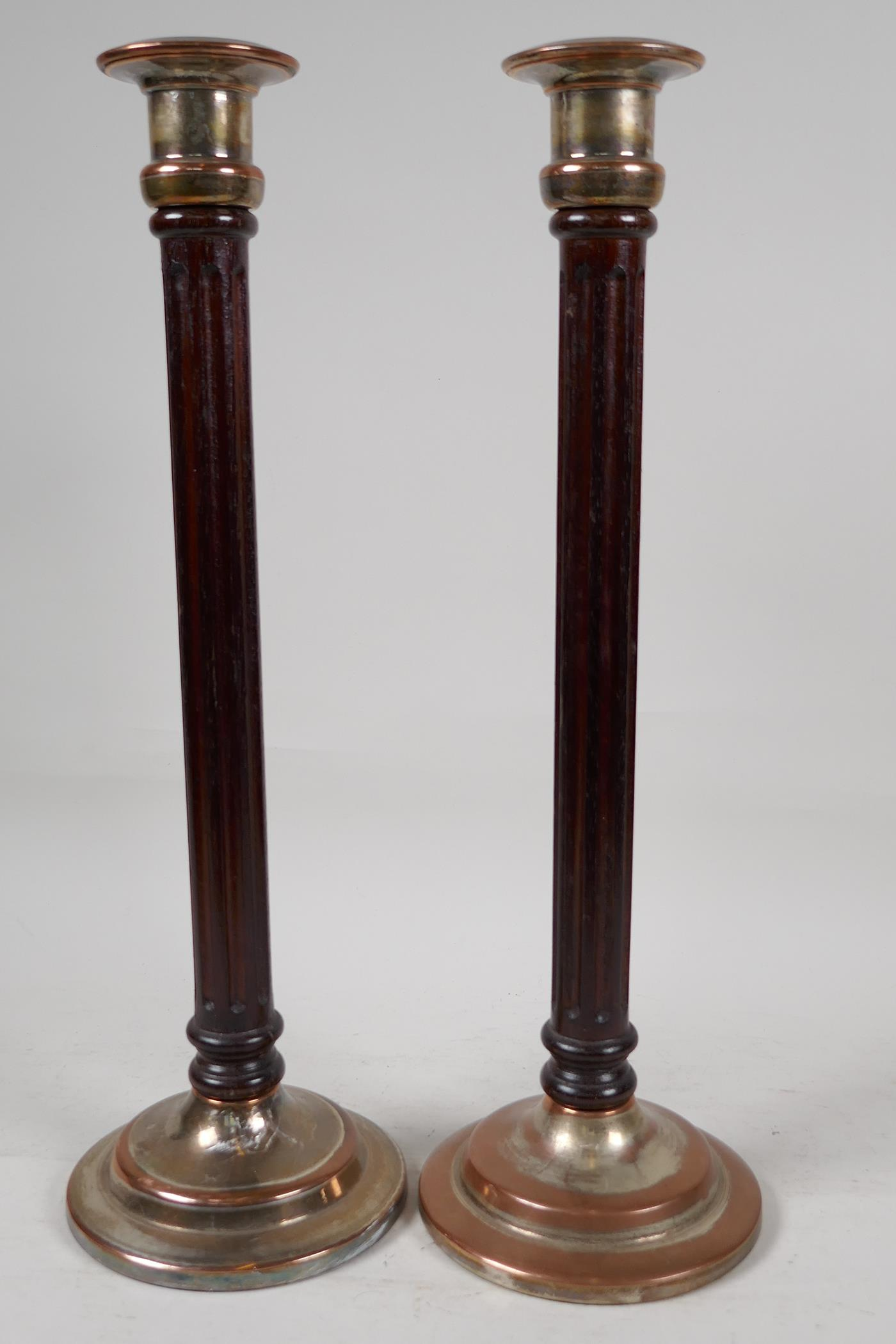 """A pair of ribbed column wood and plated metal candlesticks, 16"""" high"""